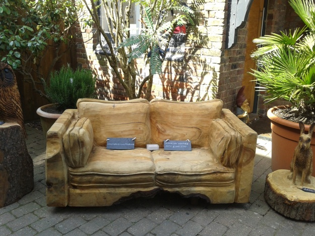 A sofa carved from a whole tree trunk, found in an Arundel shop.  looks comfy, doesn't it?