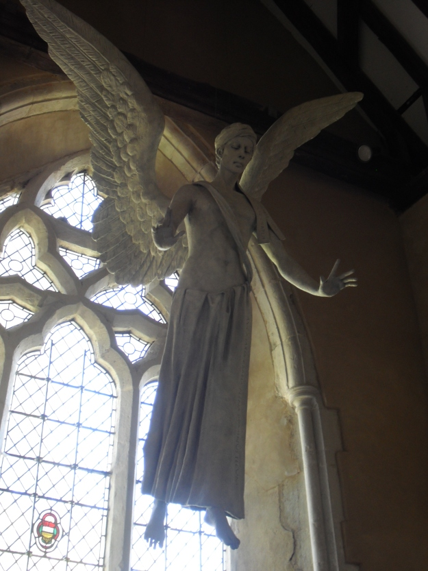 Stunning sculpture of the Archangel Gabriel by Philip Jackson (2009) suspended before the North transept window of The Church of St Mary and St Gabriel, South Harting.