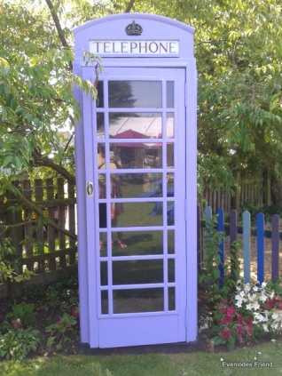 Lilac Phone Box found in the garden of a pub in Dersingham, Norfolk.  Doesn't that warm your heart?