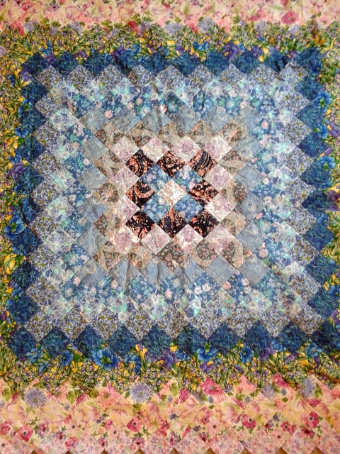Saxlingham Summer Blues:  Partially finished, hand stitched quilt made by me.  Each square is 4x4cm.