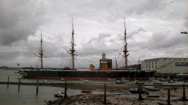 HMS Warrior, the Royal Navy's first iron-clad warship, seen from Portsmouth Harbour train station.